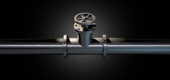 Metal Shutoff Valve. A metal shutoff valve attached to a metal pipe with bolts on an isolated dark background Stock Photo