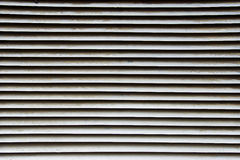 Metal shutter background. Abstract closeup photo of a metal shutter Royalty Free Stock Photo