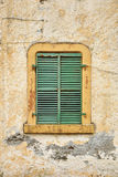 Metal Shutters. Old window with green metal shutters stock photography