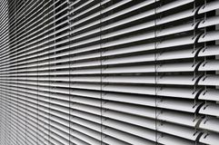 Metal shutters at glass facade Royalty Free Stock Images