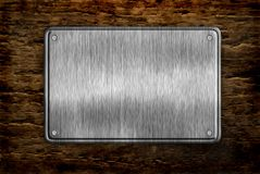 Metal sign. On wood plank background Stock Photography