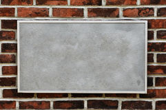 Metal Sign on Brick Wall Stock Photo