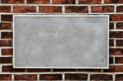 Metal Sign on Brick Wall stock photo