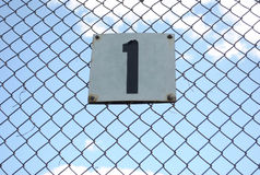 Metal sign on a fence. Royalty Free Stock Image
