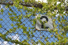 Metal sign on a fence. Stock Photography