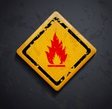Metal sign fire. On a dark background. Vector image Stock Image