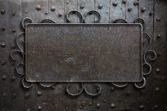 Metal sign plate on old medieval door Stock Photography