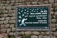 Sign: `Beware of hornet attack` on Lions rock / Sigiriya stock image