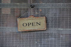 Metal sign reading 'open' on screen door Royalty Free Stock Images