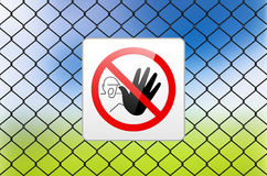 Metal sign RESTRICTED AREA - NO ENTRY on metal fence Royalty Free Stock Photos