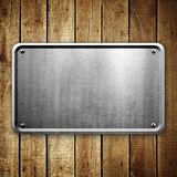Metal sign on wood plank background Stock Photos