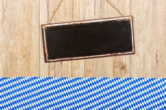 Metal sign on a wooden wall with Bavarian decor Royalty Free Stock Image