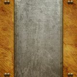 Metal signboard on old wooden background Stock Photo