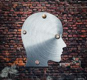 Metal silhouette of human head on the wall Stock Photography