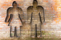Metal silhouette sign of a man and woman Royalty Free Stock Images