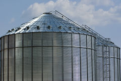 Metal silos. Two metal silos against a blue sky background Stock Images