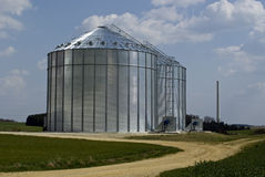 Metal silos. A pair of metal silos in a field Stock Images
