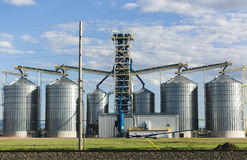 Metal Silos on Large Farm Stock Photos
