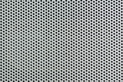 Metal silver Background with Holes. Metal Grid. Stock Images