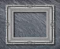 The metal silver frame on on black slate background stock images