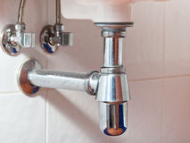 Metal sink siphon and drain Stock Photo