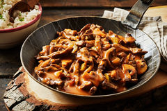 Metal skillet filled with rich beef stroganoff Royalty Free Stock Image