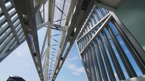 Metal sleeperless railway at testing ground low angle shot. Metal shining sleeperless railway overpass against clear blue sky at testing ground on summer day low stock video footage