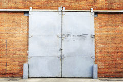 Barn door. Closeup of metal sliding barn door in brick wall Stock Photo
