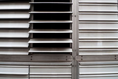 Metal slotted windows. Stainless steal slotted metal windows with one open royalty free stock images
