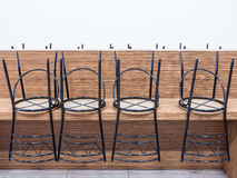 Metal small chair were neatly on a wooden table. Royalty Free Stock Photo