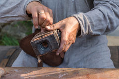 Metal smith prepares form sandbox Royalty Free Stock Image