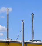 Metal smoke stacks of a factory Royalty Free Stock Photo