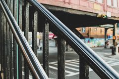 Metal smooth handrails at the subway entrance in Brooklyn royalty free stock image