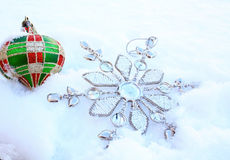 Metal snow flake and bauble Stock Photography