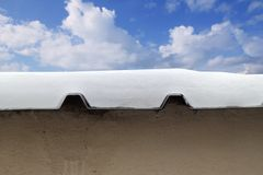 Metal snow roof meltwater detail blue sky Stock Image