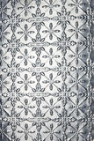 Metal Snowflake Christmas Background. A pressed or stamped metal background with a snowflake or star pattern stock image
