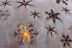 Metal Snowflakes Fire back lit. Tarnished Steel Metal Snowflakes fire back lit orb back light stock photography