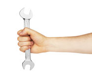 Metal spanner in hand Royalty Free Stock Photography