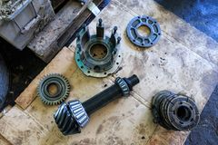 Metal spare parts: bearings, gears, shaft, gear shaft. Spare par royalty free stock image