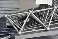 Metal spatial triangular structure. Metal spatial triangular structure close-up. The rods combined in ball nodes Royalty Free Stock Images