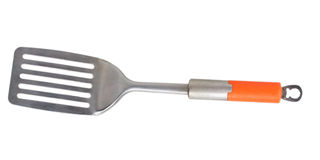 Metal spatula with orange handle Stock Images