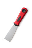 Metal spatula with a red handle on a white background Stock Photos