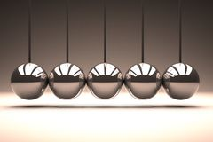 Metal spheres bouncing in line Royalty Free Stock Photos