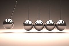 Metal spheres bouncing in line Stock Photography