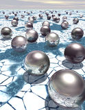 Metal spheres on an icy landscape - science fiction background Stock Photography