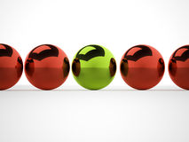 Metal spheres one is green Royalty Free Stock Photo