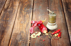 Metal spice grinder with red hot peppers and bay leaf Stock Photo