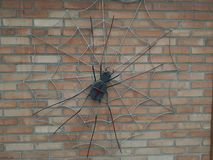 metal spider on a brick wall black royalty free stock photos