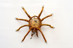 Metal spider with built-in clockwork on white background, steampunk style. Close-up royalty free stock images