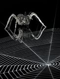 Metal spider and spiderweb Stock Photography